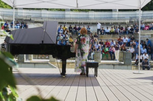 Pianist playing the piano in amphitheater